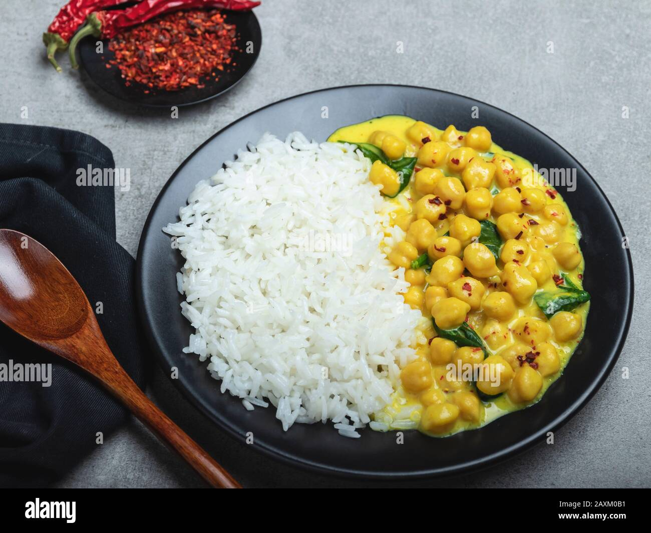 rice, chickpeas with coconut milk and curry. vegetarian dish Stock Photo