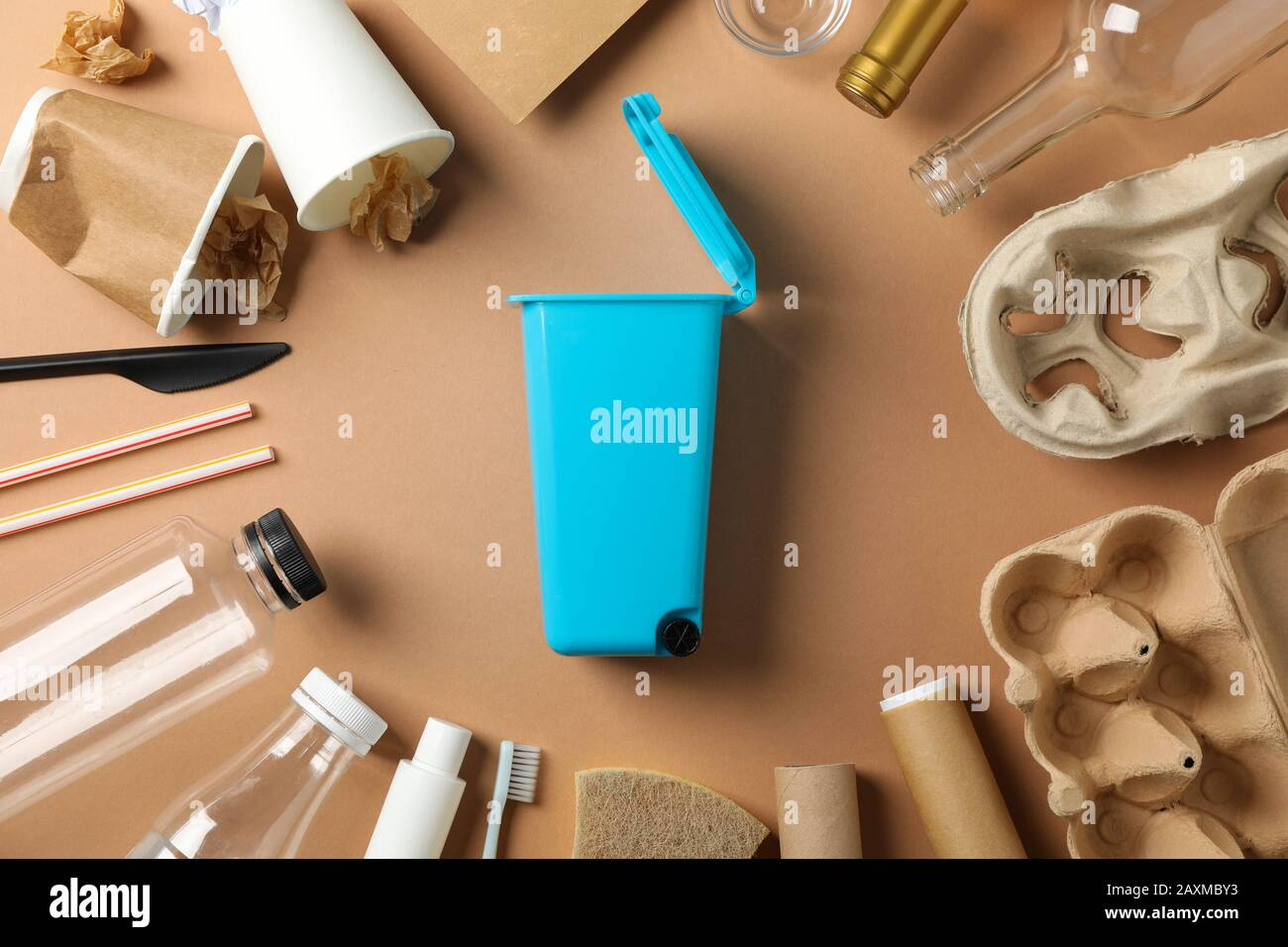 Recycle bin and different trash on craft background, top view Stock Photo