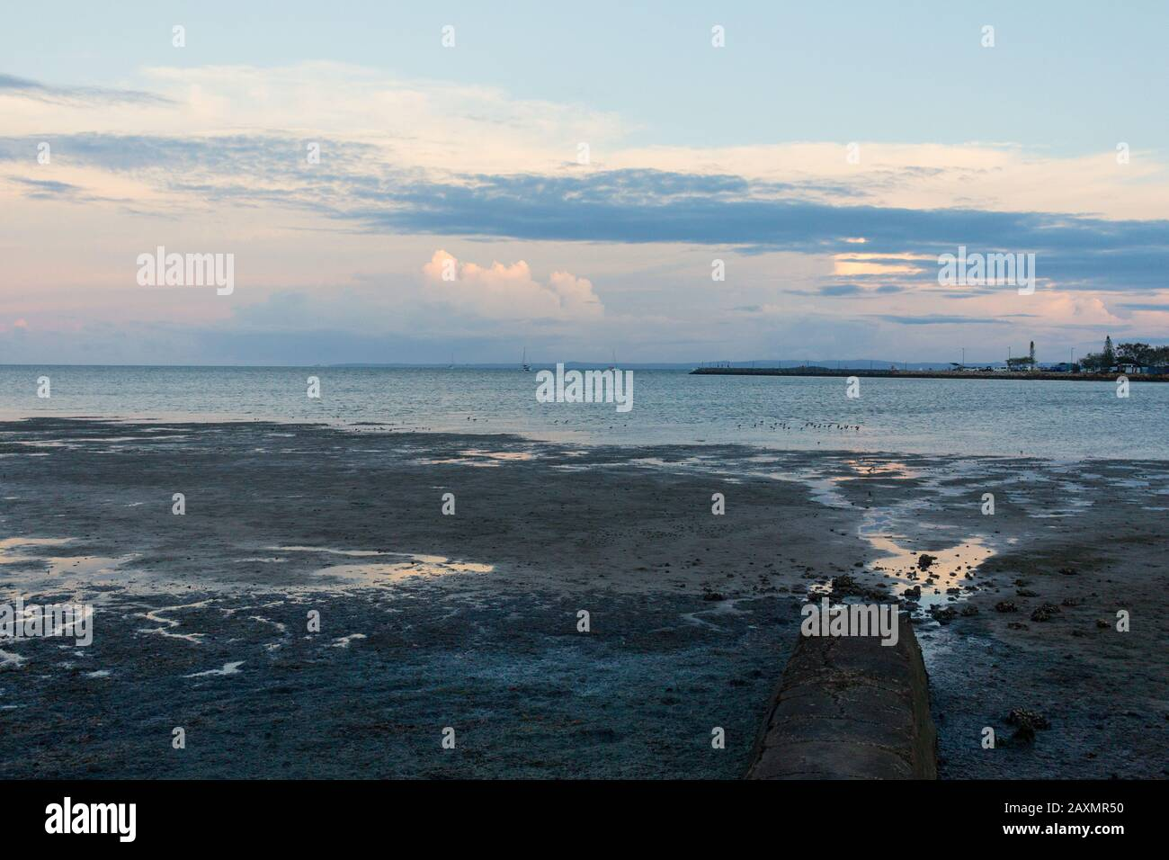 Scenic view of sea against dramatic sky during sunset Stock Photo