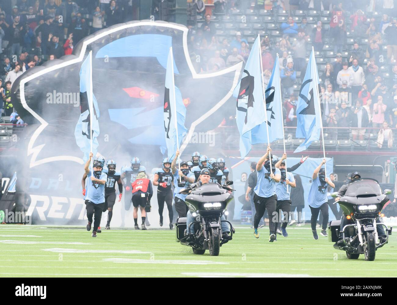 Arlington, Texas, USA. 9th Feb, 2020. Motorcycles and players come on the field before the 1st half of the XFL game between St. Louis Battlehawks and the Dallas Renegades at Globe Life Park in Arlington, Texas. Matthew Lynch/CSM/Alamy Live News Stock Photo