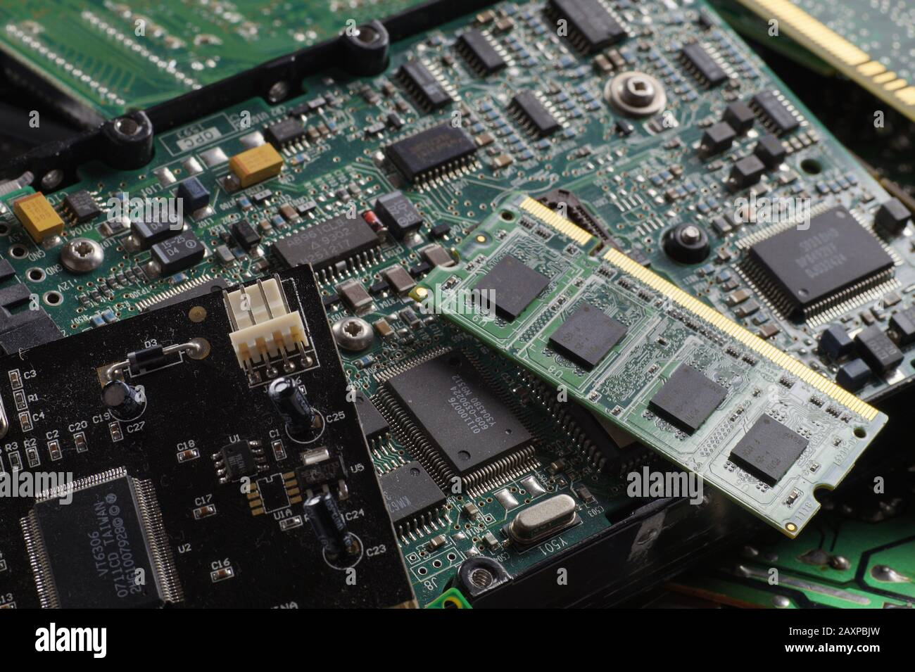 RAM memories, hard drives, expansion cards. Used consumer electronics components. Stock Photo
