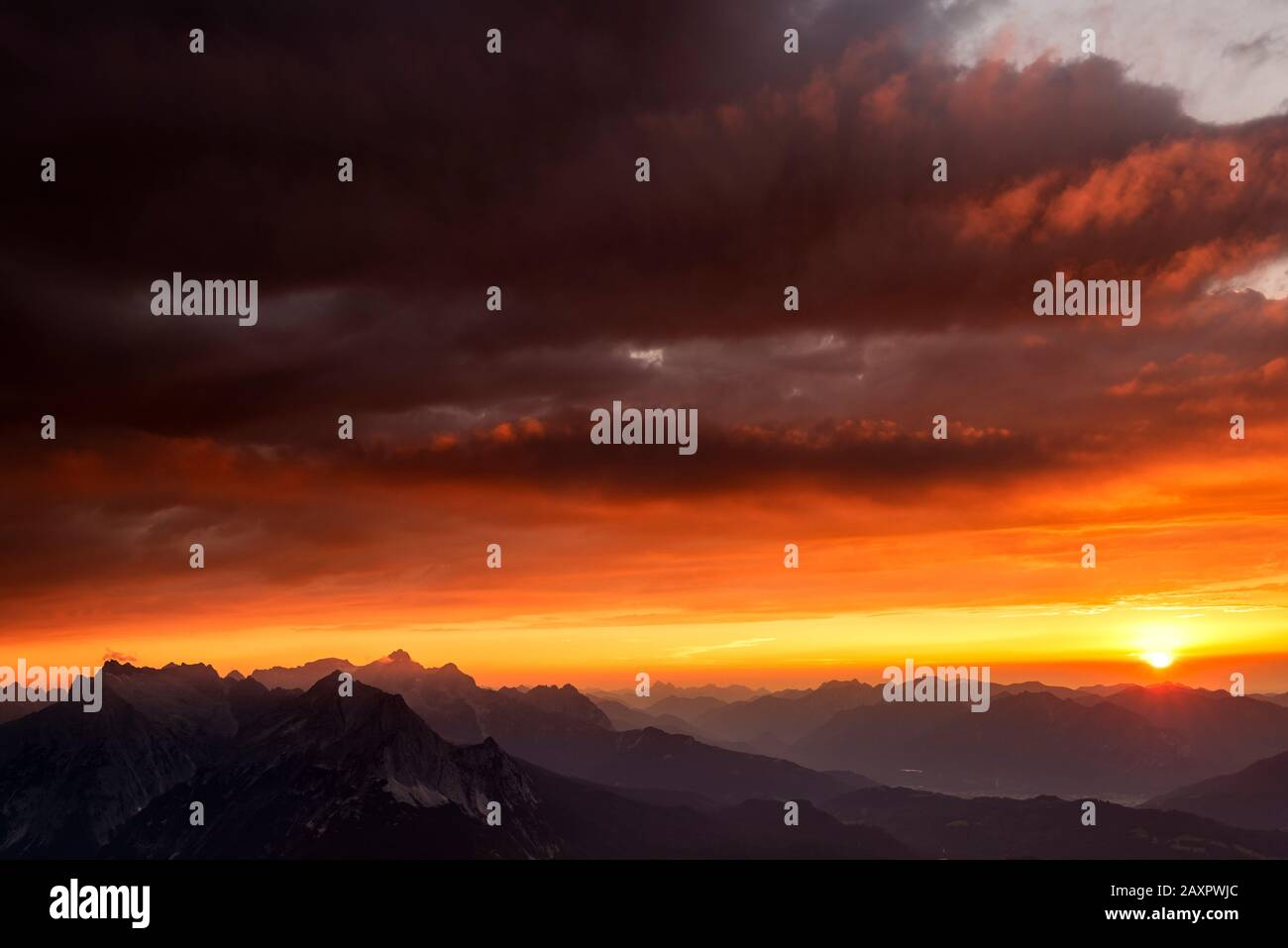 Sunset in the Werdenfelser Land with Zugspitze and Wetterstein mountains, as well as dramatic clouds Stock Photo