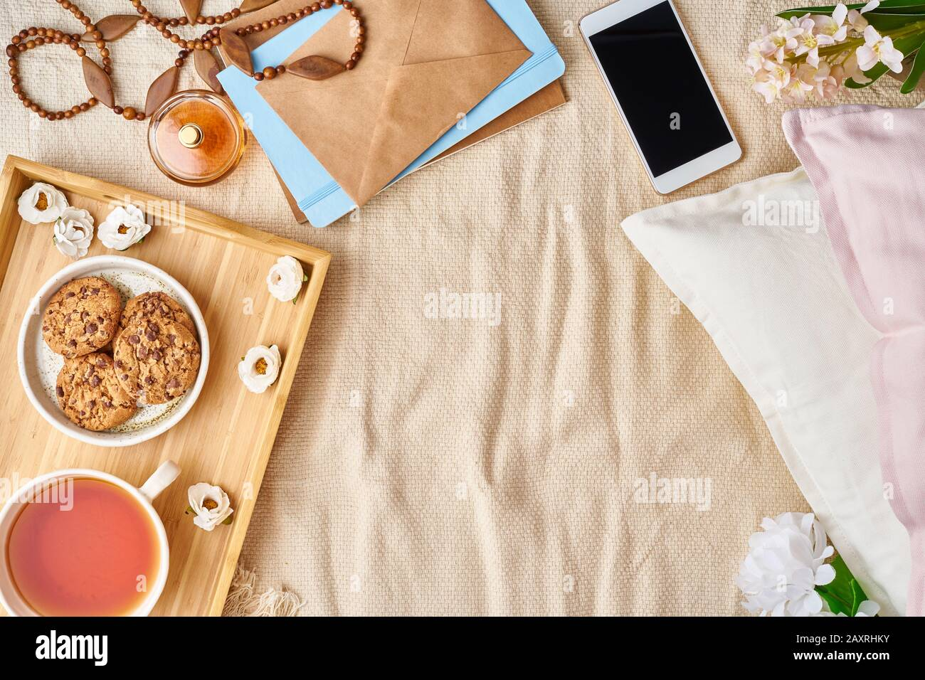 Mockup With Women S Accessories On Bed Tea Cookies Pillows Flowers Letter Notebook Stock Photo Alamy