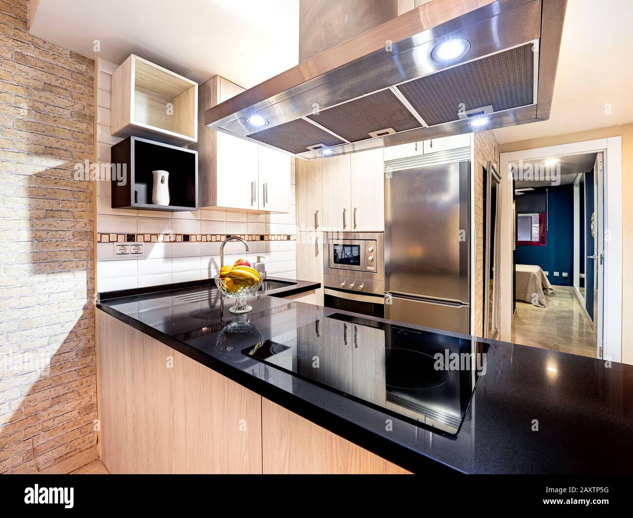 New Stylish Bright Kitchen With Wooden Cabinets Next To The Living Room Spacious Modern Fully Equipped Appliance Interior With Stone Desk Ceramic St Stock Photo Alamy