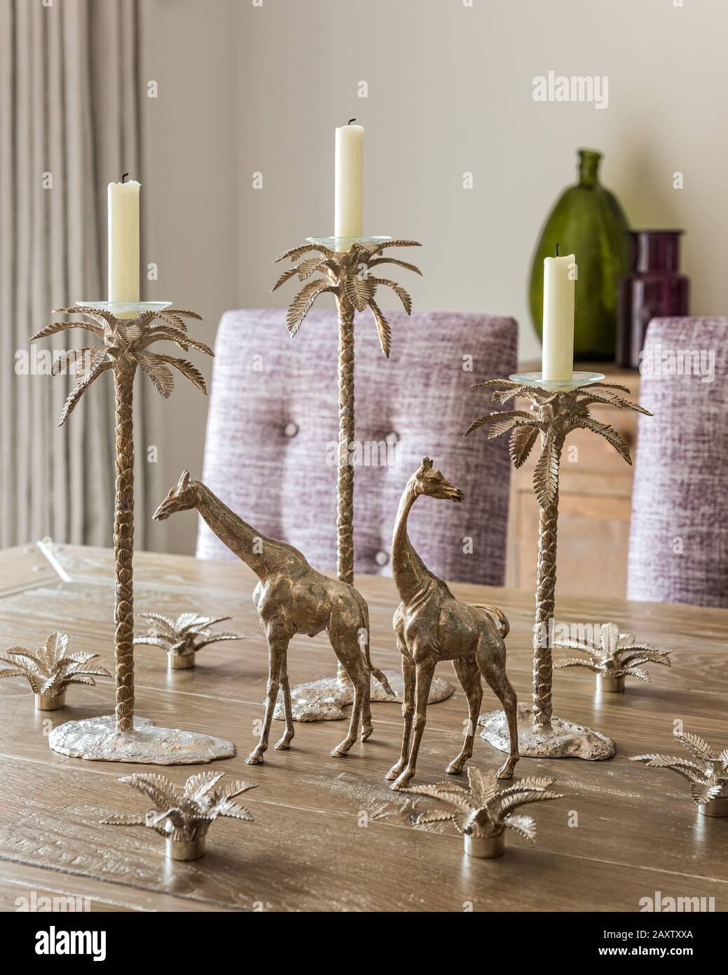 Silver Candle Holders And Giraffe Ornaments On Dining Table Stock Photo Alamy