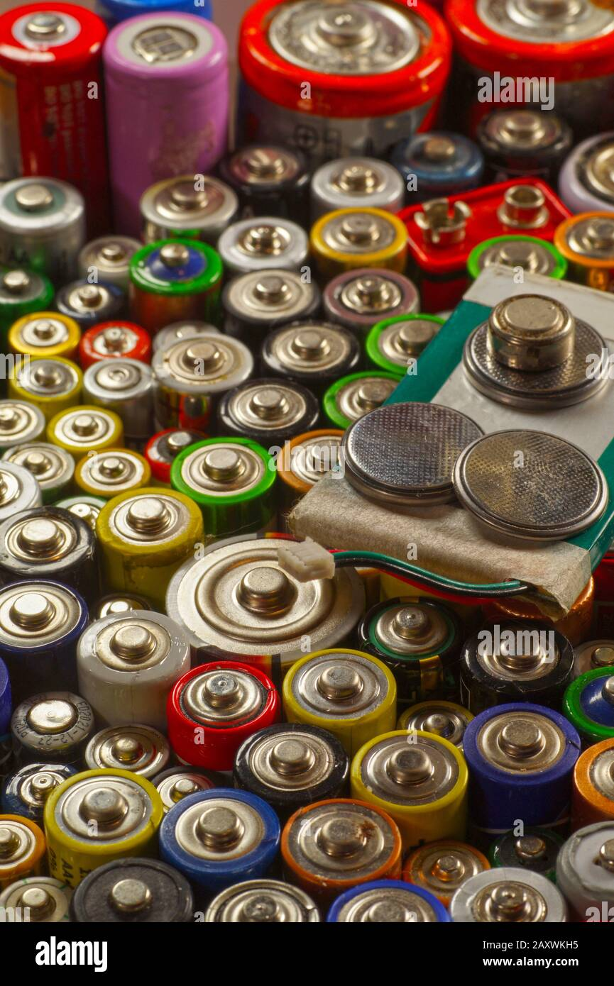 Recycling. Dozens of types, sizes, colors of used batteries and accumulators. Stock Photo