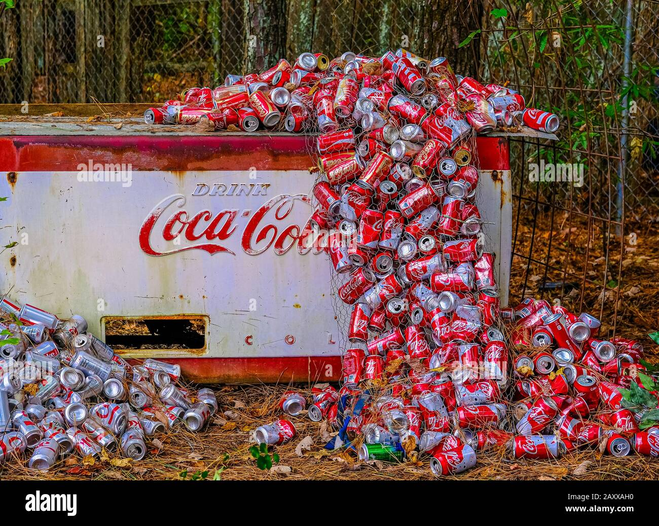 Cola Cans PIled Around Old Cooler Stock Photo