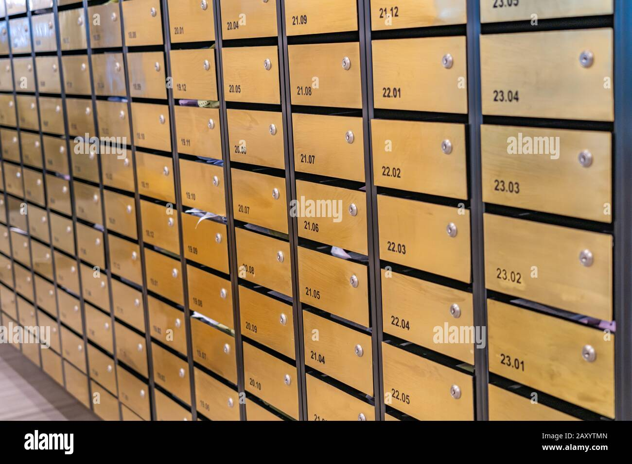 Mailbox array in postal room of apartment building Stock Photo