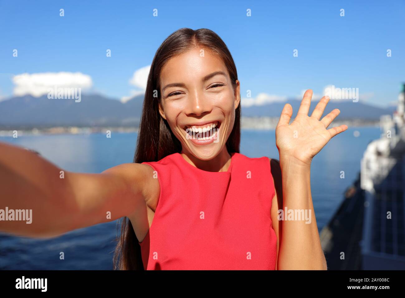 Asian Woman Talking On Video Chat Mobile Phone App Or Taking