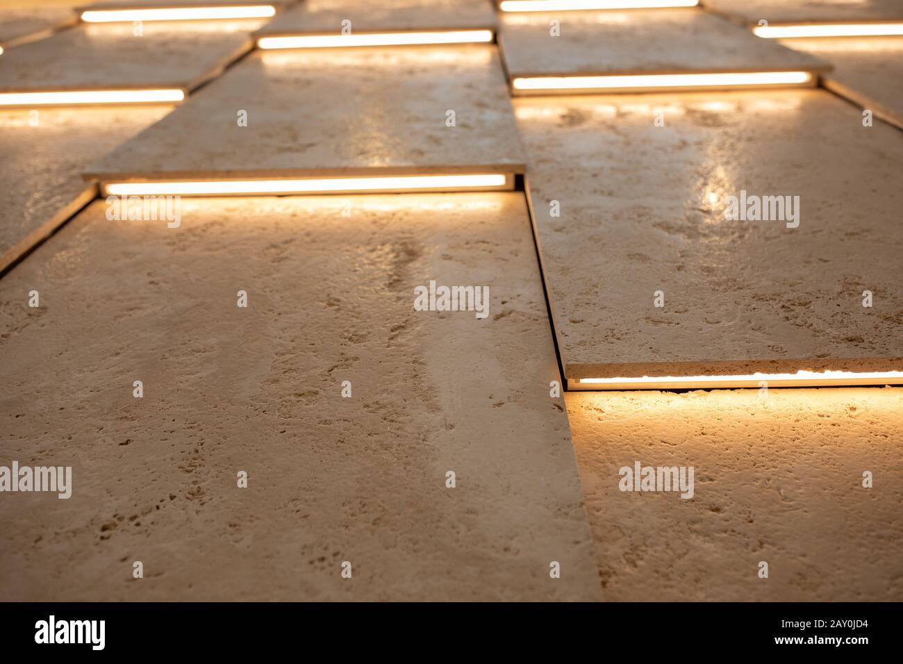 Wall or ceiling viewed in backlight. Tilt view of lath panels resembling structure of blinds or shutters. Abstract modern architecture or interior Stock Photo