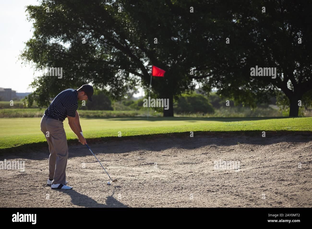 Golfer playing golf Stock Photo