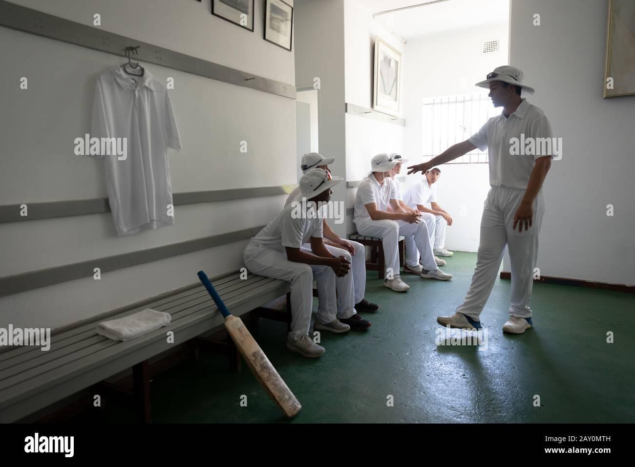 Team in the locker room preparing the game Stock Photo