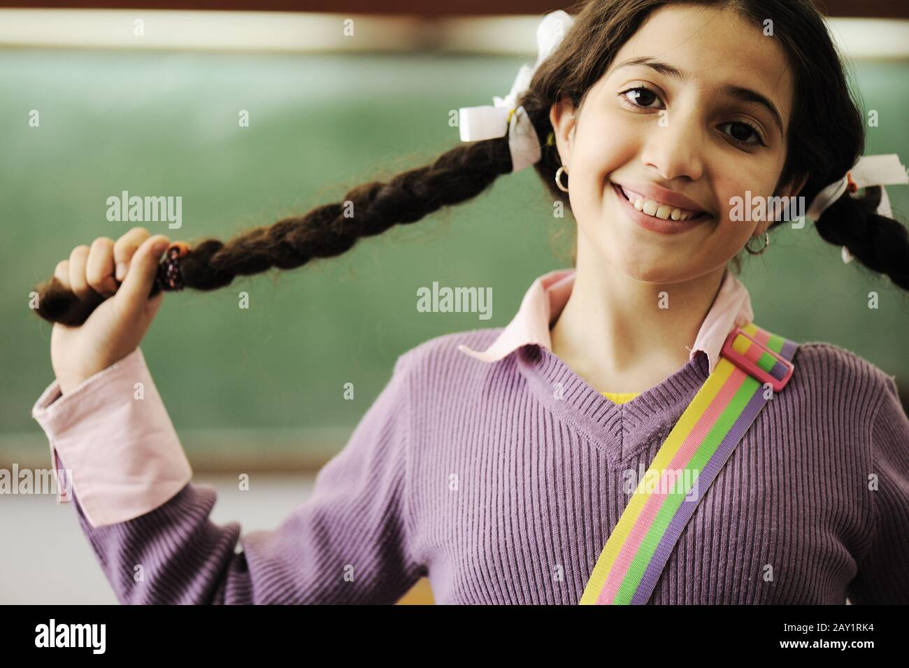 Cute Little Girl With Hair Braids At School Stock Photo 343633224