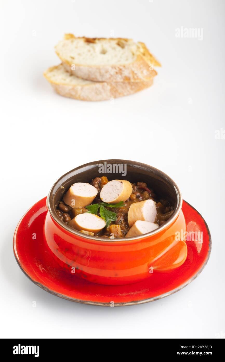 Lentil soup with wiener Stock Photo