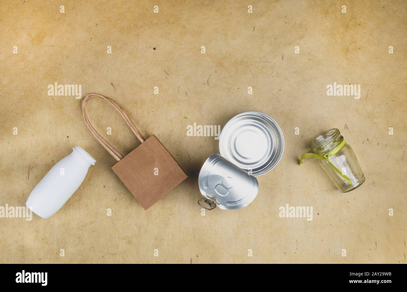 recycling concept, composition of plastic bottle, paper bag, metal tin, glass with space for your text Stock Photo