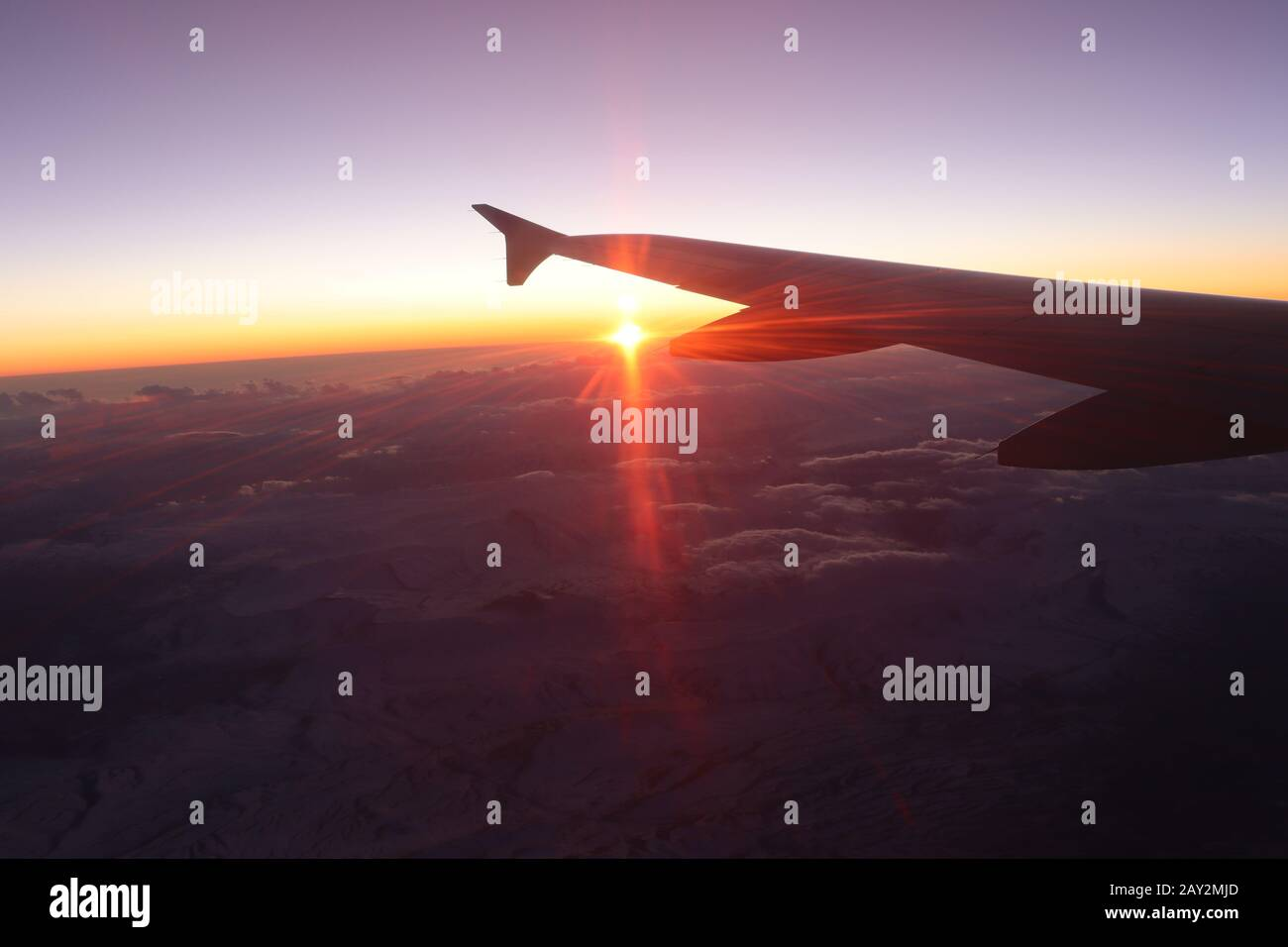 Sunset view from the airplane window Stock Photo