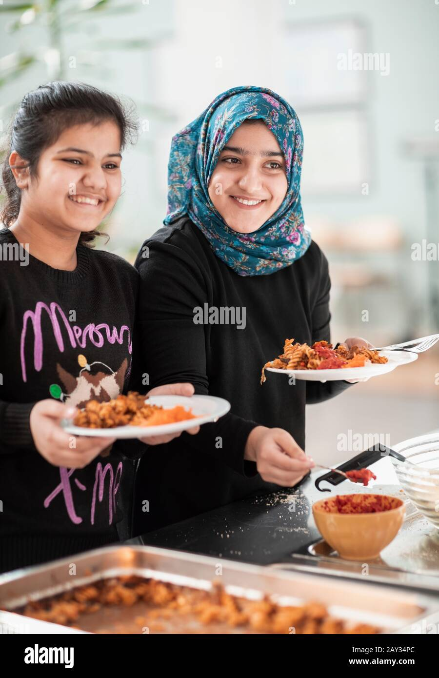Smiling girls in school canteen Stock Photo
