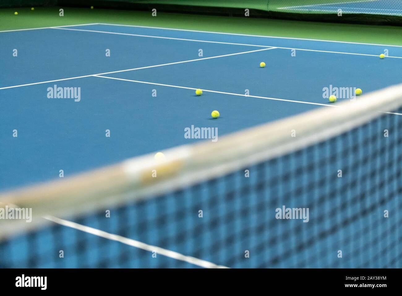 Tennis court with balls Stock Photo