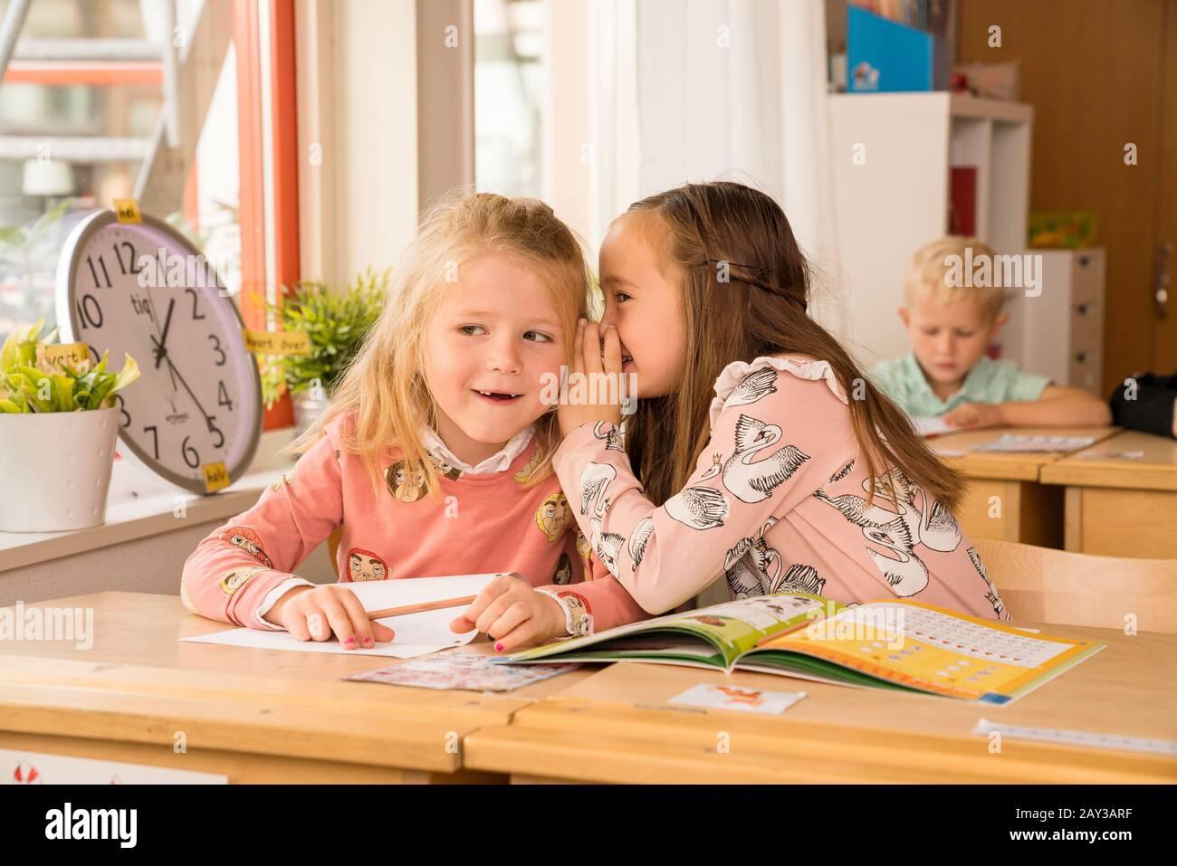 Girls in classroom Stock Photo