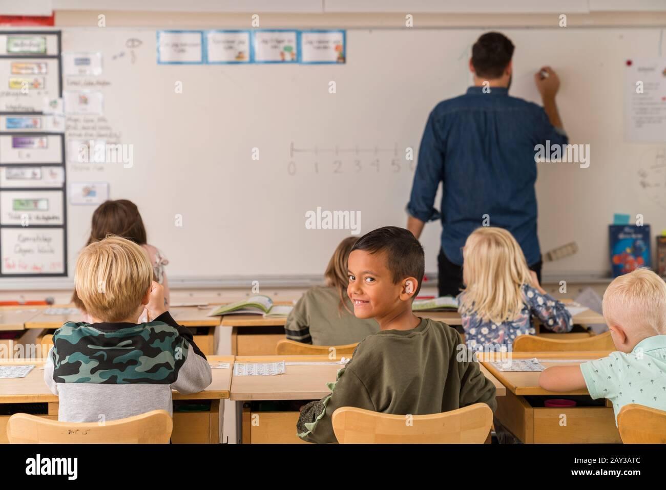 Schoolchildren in classroom Stock Photo
