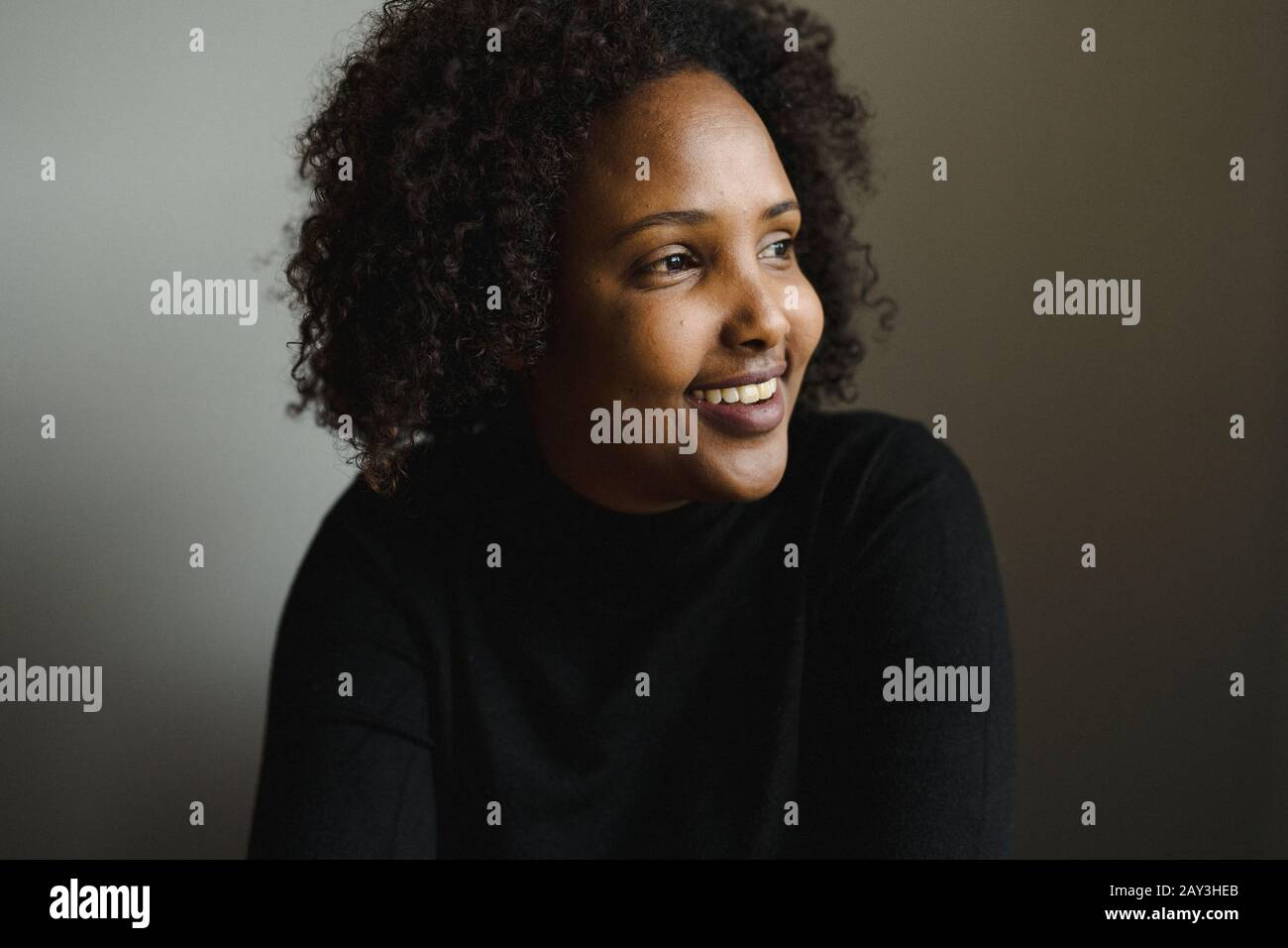 Portrait of woman looking away Stock Photo