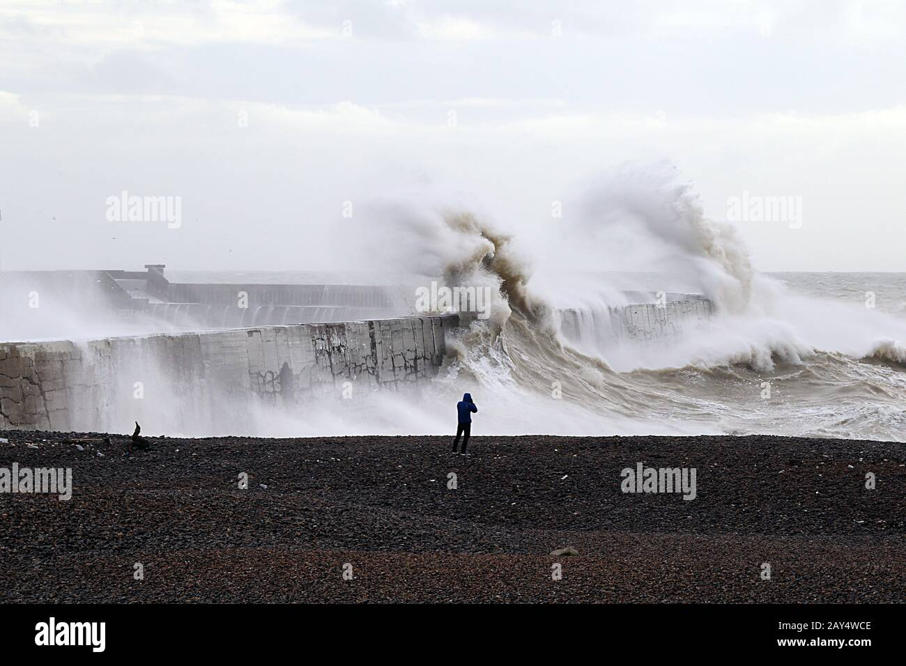 Giant waves crash against the breakwater after storm Ciara, at Newhaven East Sussex UK Stock Photo