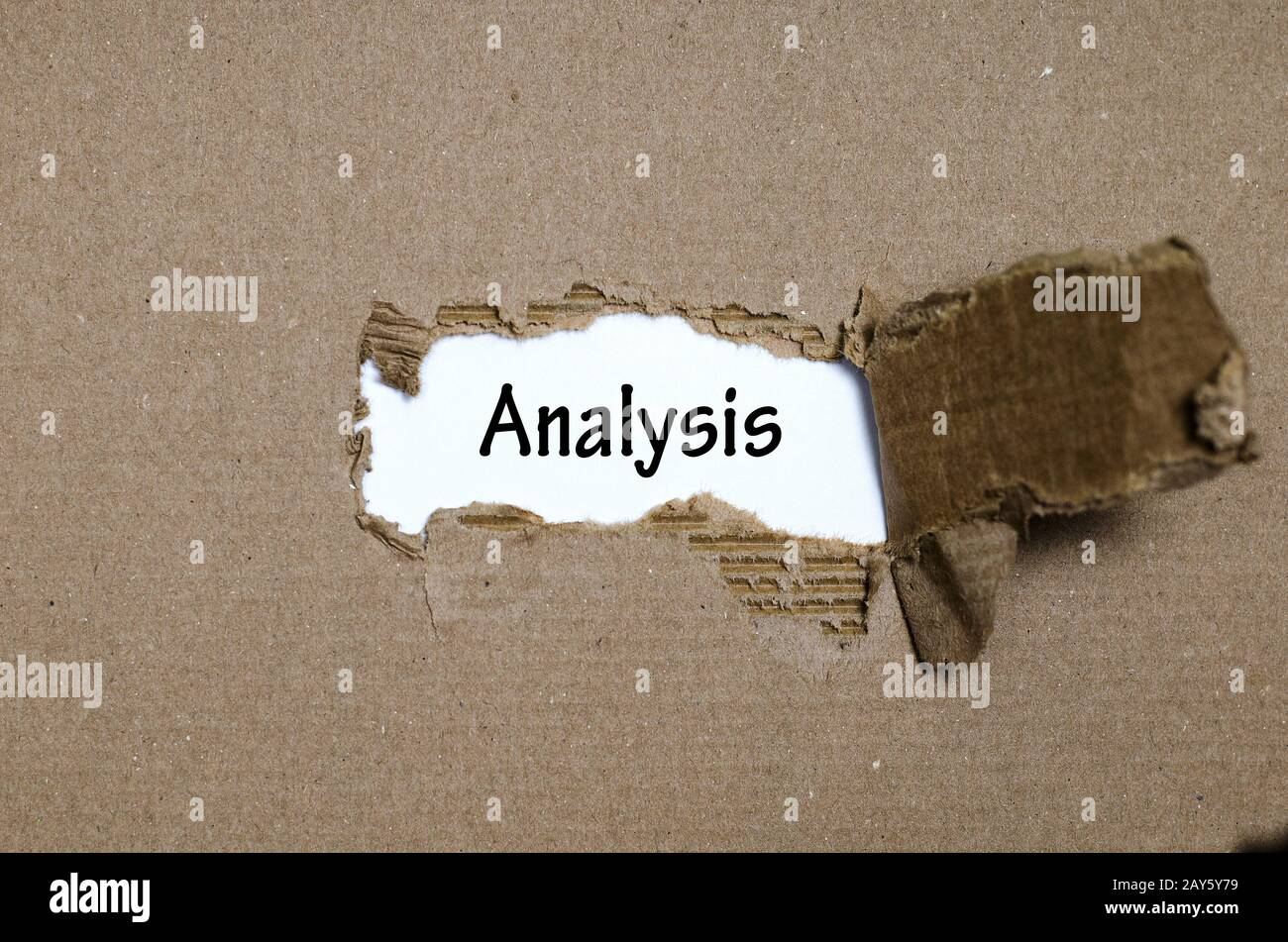 The word analysis appearing behind torn paper Stock Photo