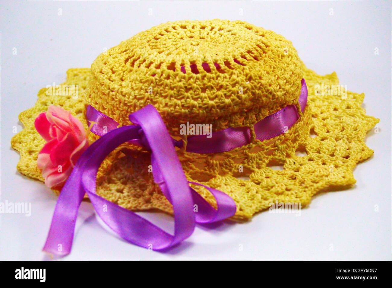 Hat realized by means of hooks with a pink ribbon. Stock Photo