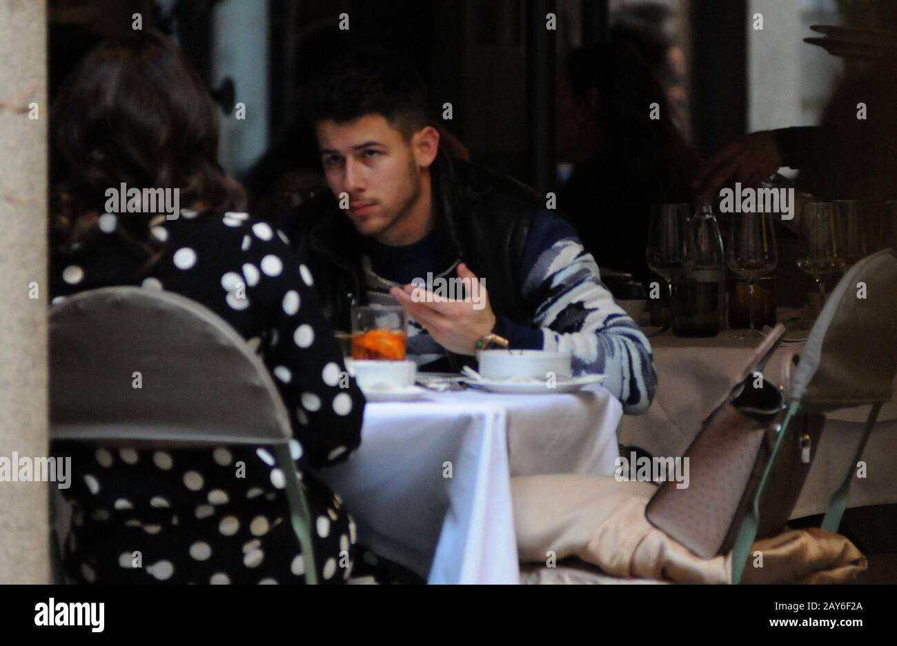 """Milan, Italy. 14th Feb, 2020. Nick Jonas and wife Priyanka Chopra lunch in the center Nick Jonas, one of the 3 brothers of the famous musical group """"JONAS BROTHER"""" in concert this evening in Milan, surprised at lunch in a well-known restaurant in the center together with his wife Priyanka Chopra, actress model and Indian singer, winner of the beauty contest Miss World 2000, first Bollywood actress to have won 5 filmfare Awards in 5 different categories. In 2015 protagonist of the US TV series """"Quantico"""", and he is Goodwill Ambassador of UNICEF. Credit: Independent Photo Agency Srl/Alamy Live N Stock Photo"""