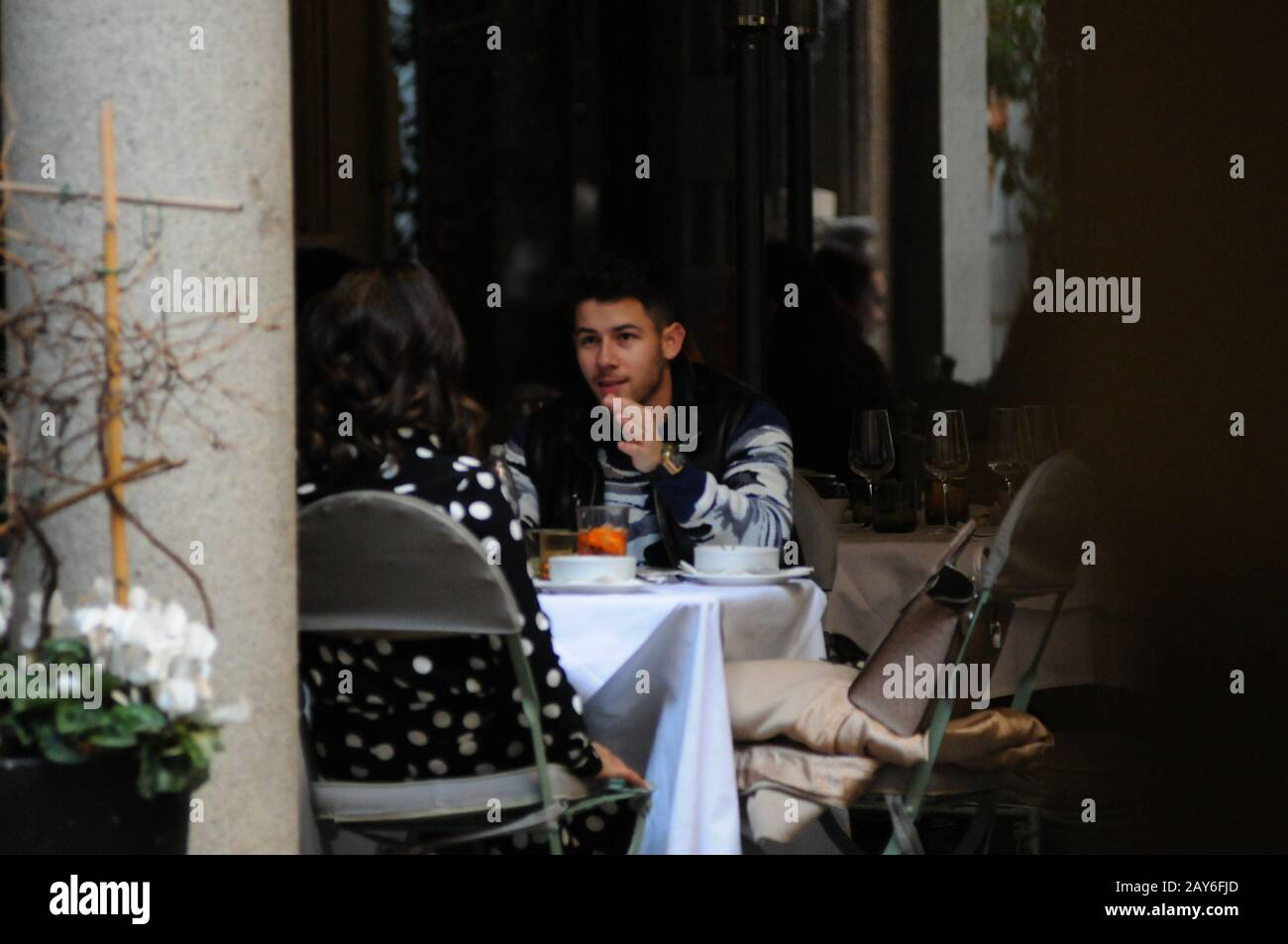 "Milan, Italy. 14th Feb, 2020. Nick Jonas and wife Priyanka Chopra lunch in the center Nick Jonas, one of the 3 brothers of the famous musical group ""JONAS BROTHER"" in concert this evening in Milan, surprised at lunch in a well-known restaurant in the center together with his wife Priyanka Chopra, actress model and Indian singer, winner of the beauty contest Miss World 2000, first Bollywood actress to have won 5 filmfare Awards in 5 different categories. In 2015 protagonist of the US TV series ""Quantico"", and he is Goodwill Ambassador of UNICEF. Credit: Independent Photo Agency Srl/Alamy Live N Stock Photo"