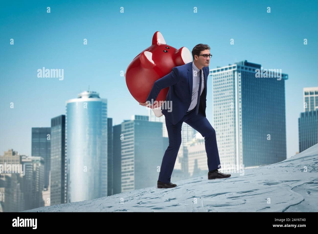 Businessman carrying the piggybank with savings Stock Photo