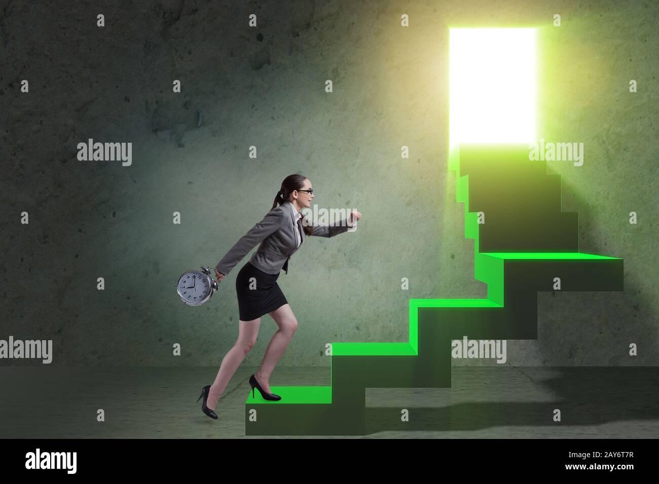 Young businesswoman climbing career ladder Stock Photo