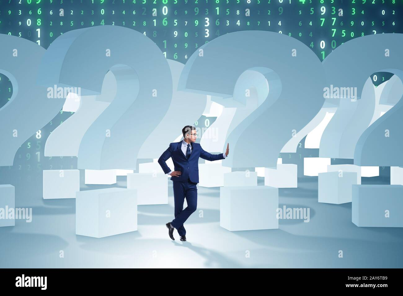 Businessman in uncertainty concept with question marks Stock Photo