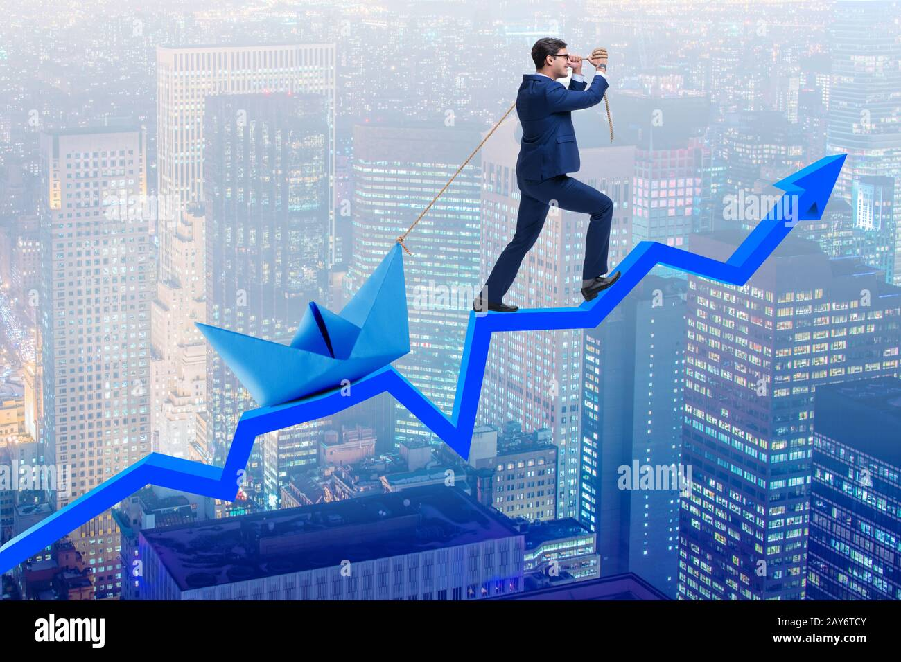 Businessman pulling boat over line chart Stock Photo