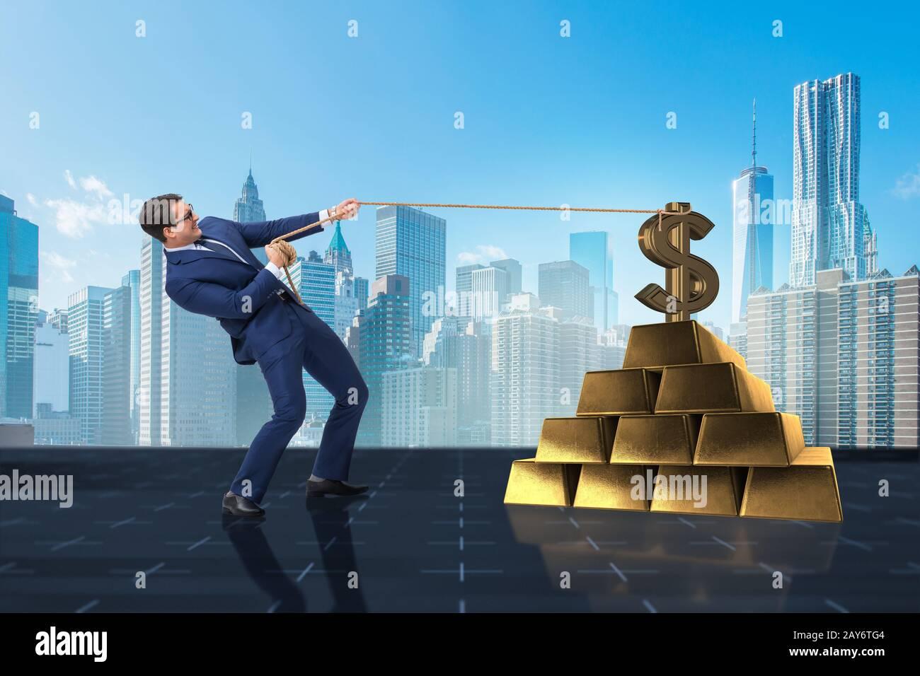 Businessman pulling dollar and gold bullions Stock Photo