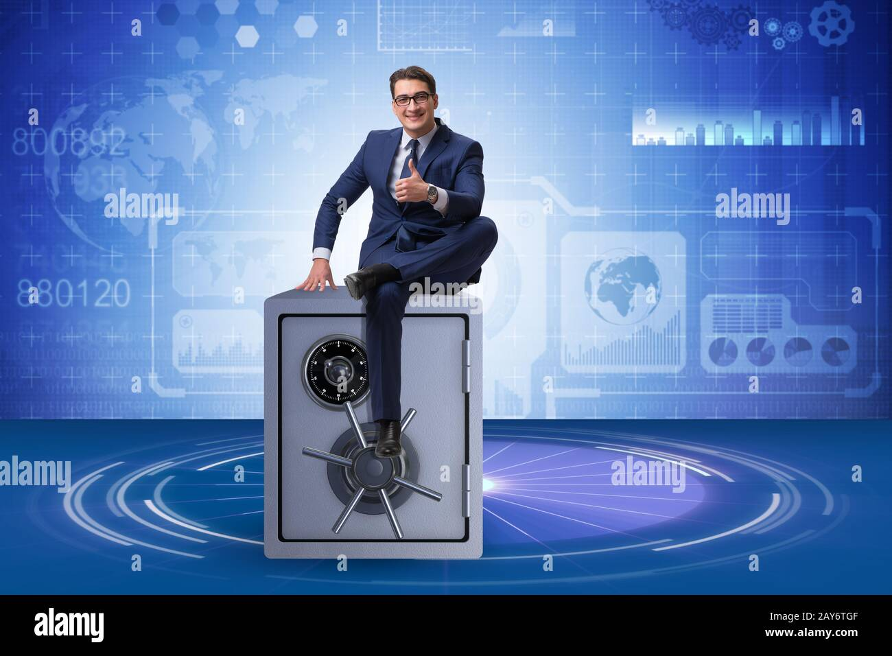 Businessman sitting on top of safe Stock Photo