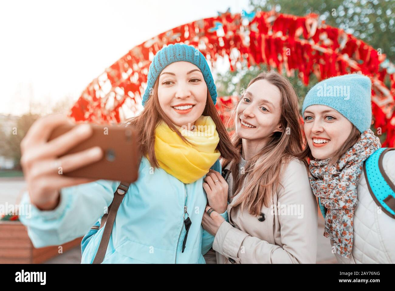 Three Best Friends Girls Pose And Take A Photo Selfie On Smartphone While Traveling At The Fall Concept Of Sisterhood Stock Photo Alamy