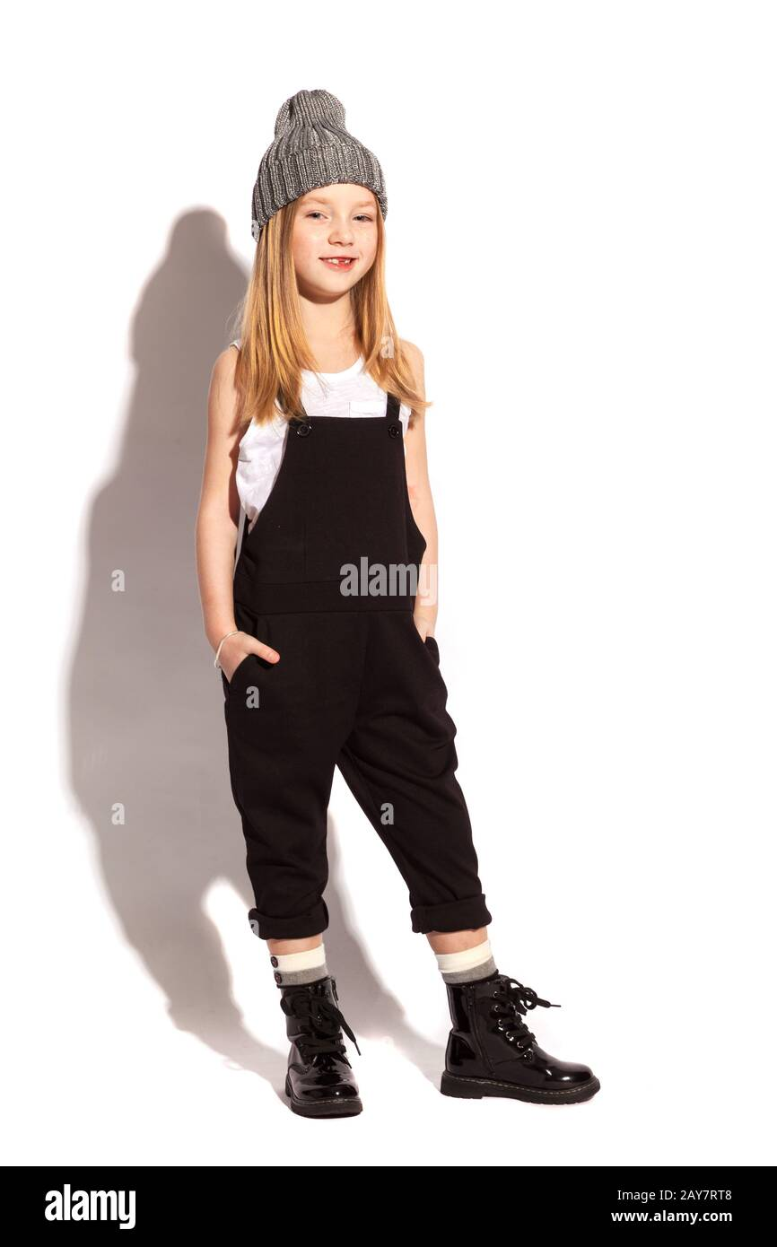 little girl in dark overall on the white background Stock Photo