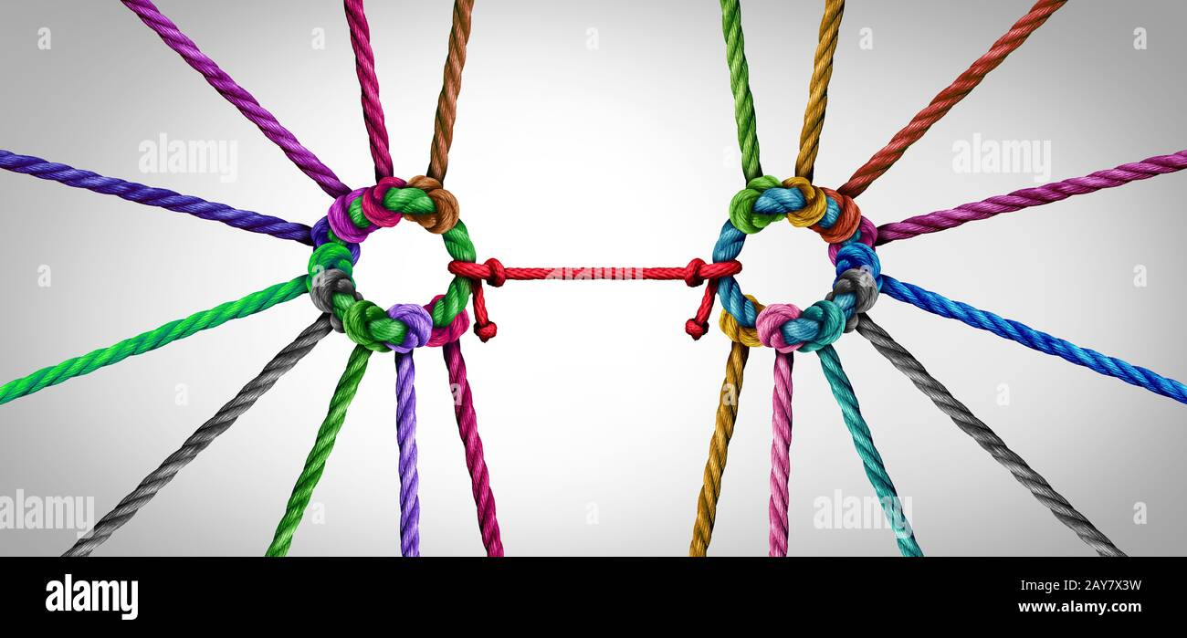 United teamwork concept as a business metaphor for joining a unity partnership as diverse ropes groups connected together as a corporate symbol. Stock Photo