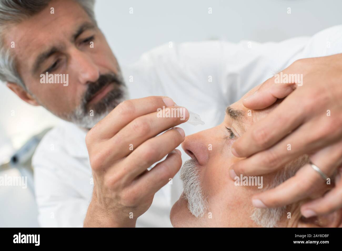Eye Specialist Putting Eyedrops To The Patients Eye Stock Photo Alamy