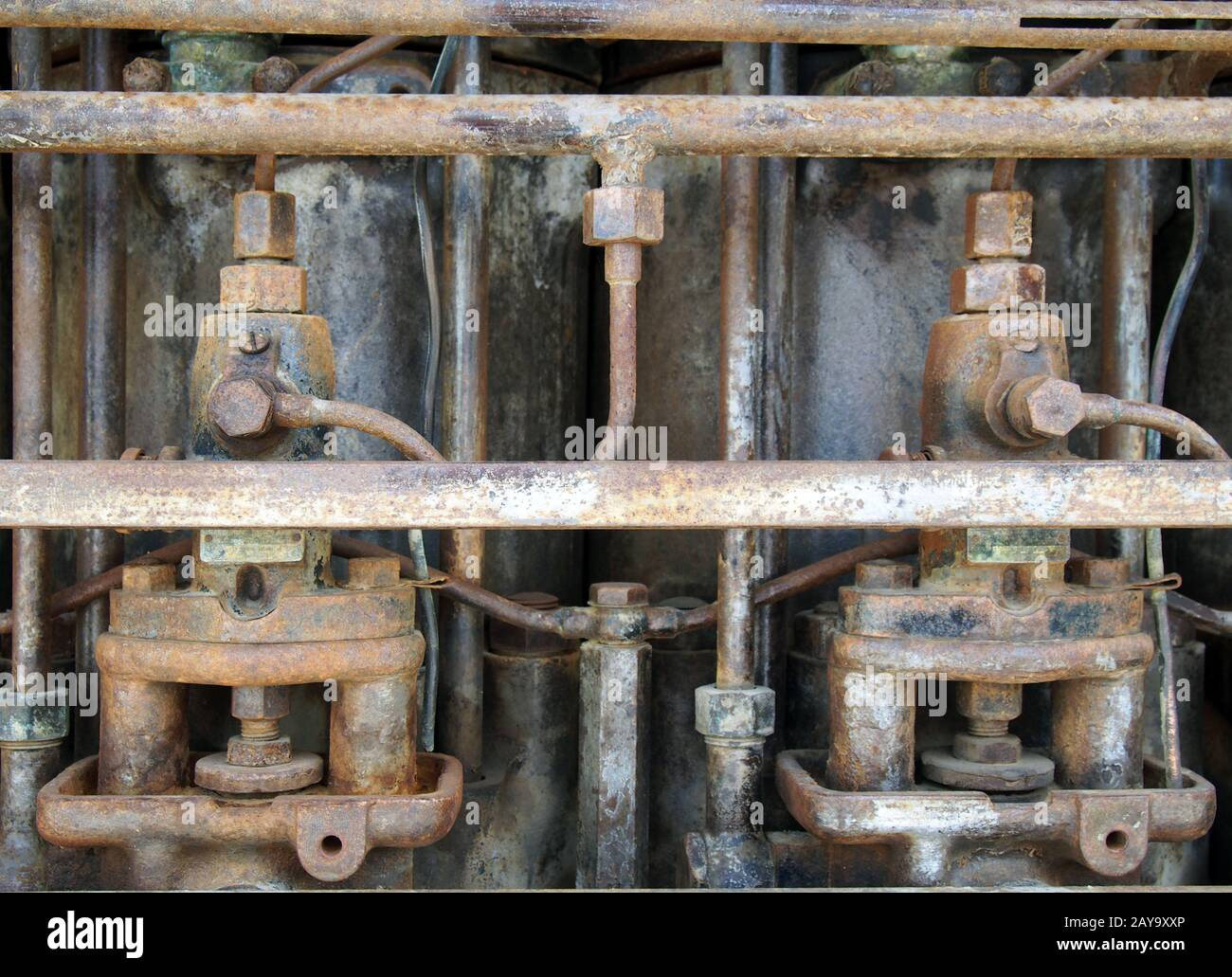 Close up of an old big rusting diesel engine with cylinders and pipes Stock Photo