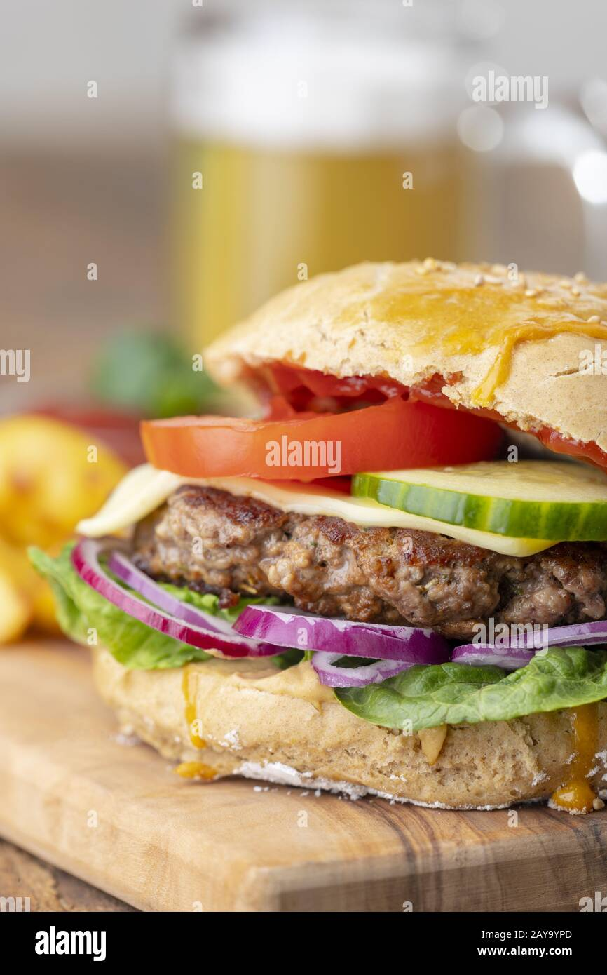 homemade burger on dark wood Stock Photo