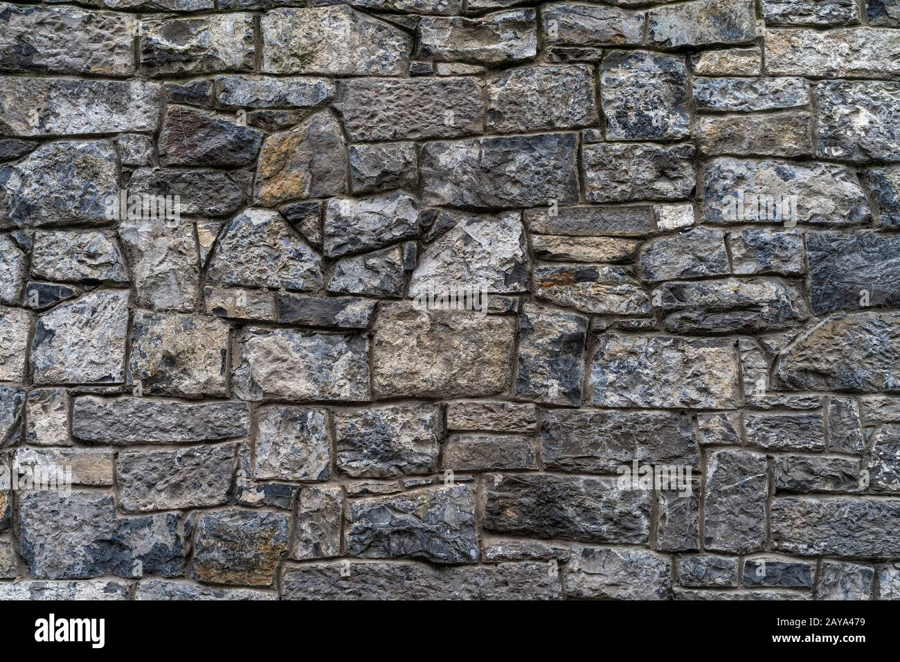 Old rustic stone wall High quality texture and background Stock Photo