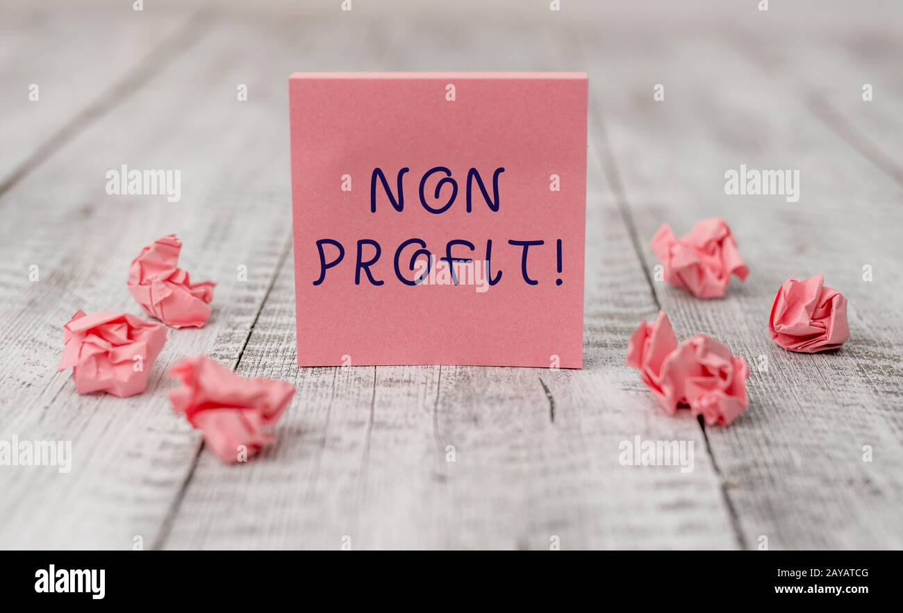 Handwriting text writing Non Profit. Concept meaning not making or conducted primarily to make profit organization Thick set of Stock Photo