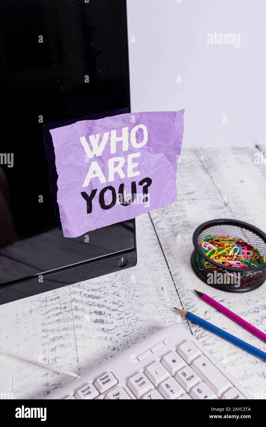 Word writing text Who Are Youquestion. Business concept for someone asking your demonstratingal background or history Note paper Stock Photo