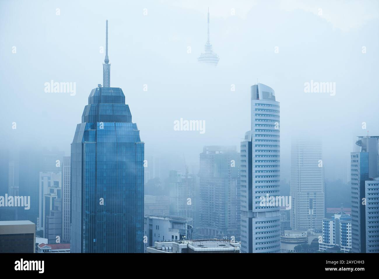 Top view of foggy Kuala Lumpur city skyline in the morning . Stock Photo
