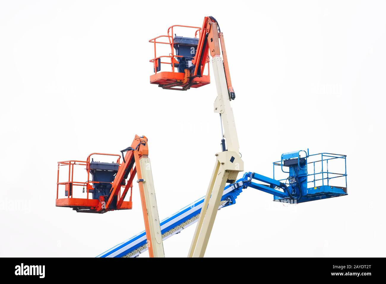 Access platform equipment powered high in sky in blue orange and yellow for high working platform height safety at construction building site Stock Photo