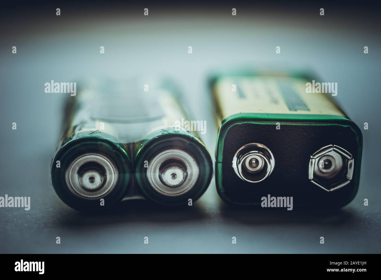 Two different types of batteries on the dark table close-up Stock Photo