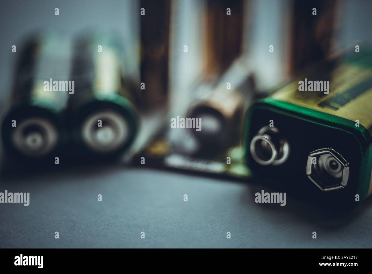 Different types of batteries on the dark table close-up Stock Photo