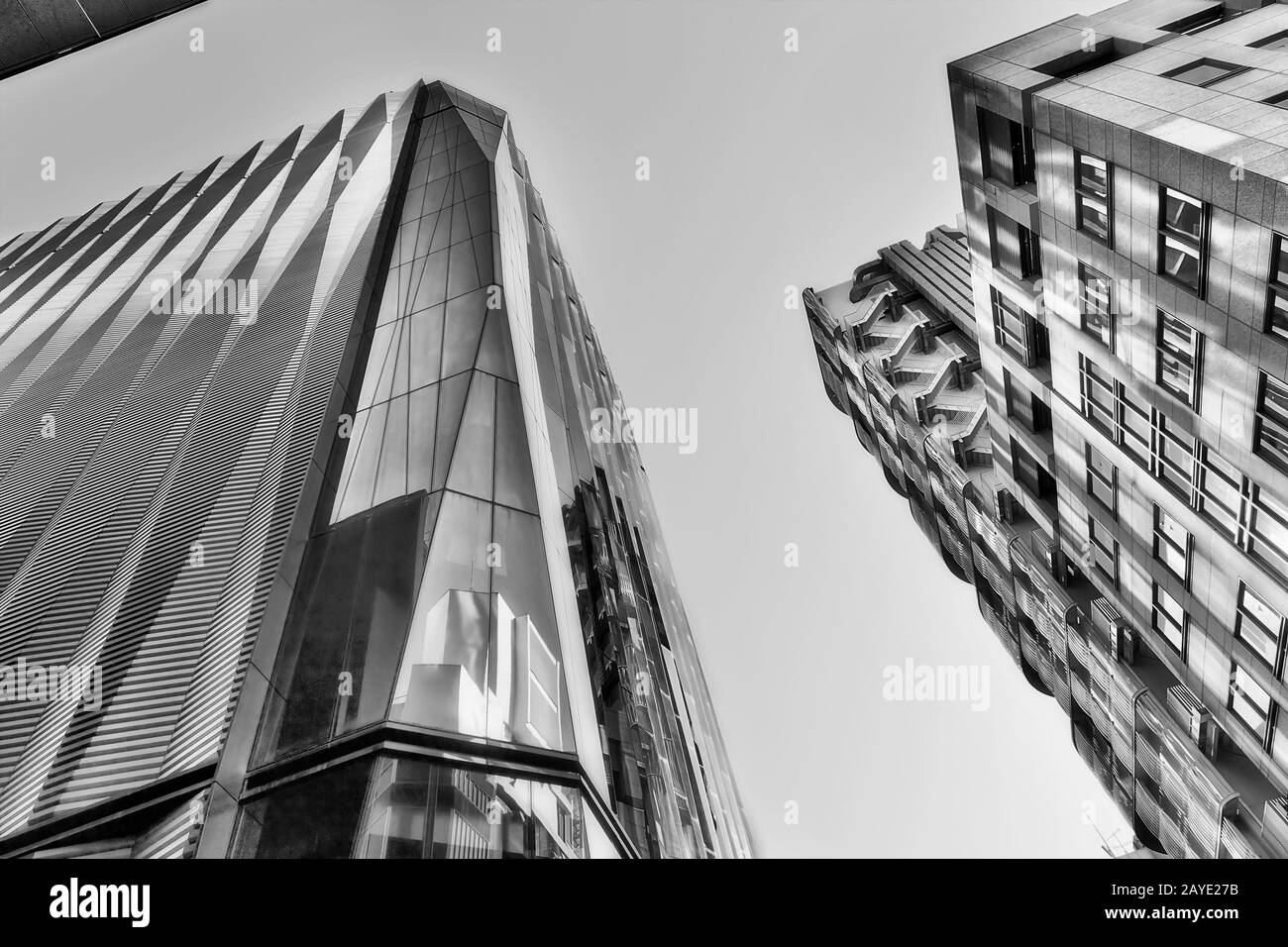 High contrast black white futuristic modern building towers in rich Tokyo district Ginza reaching the skies. Stock Photo